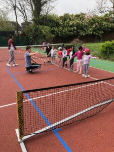 Our caoches are always here to help. Mini tennis fun on camp at Ravens LTC, N12