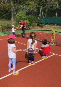 Coach Austin on mini tennis camp volley day